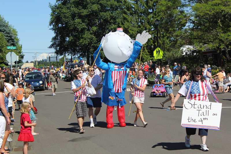 The annual parade draws crowds from across the Portland area to watch the tiny neighborhood parade.
