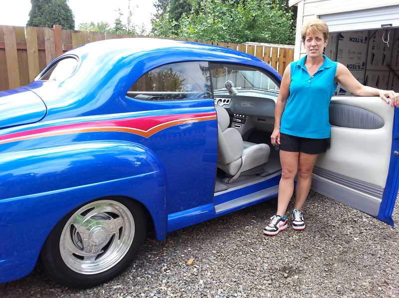 by: NEWS-TIMES PHOTOS: NANCY TOWNSLEY - Hillsboro resident Patty Logsdon fell in love with her fathers 1947 Ford Club Coupe, which he restored and customized over a nine-year period.