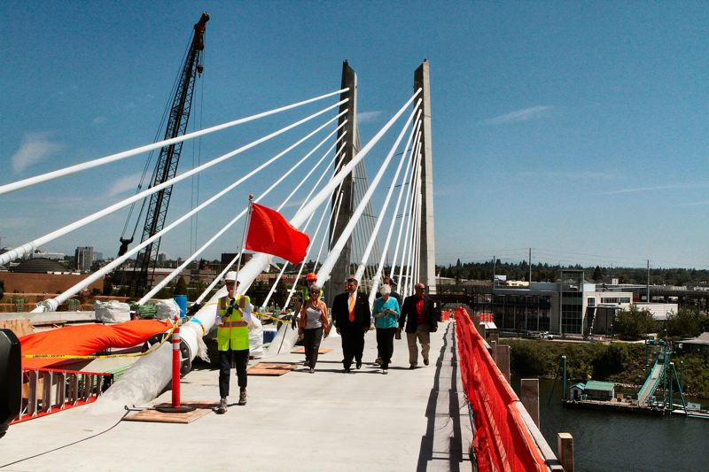 by: DAVID F. ASHTON - Approaching from the east side, Elected officials draw close to the center span of the new  TriMet Tilikum Crossing bridge.