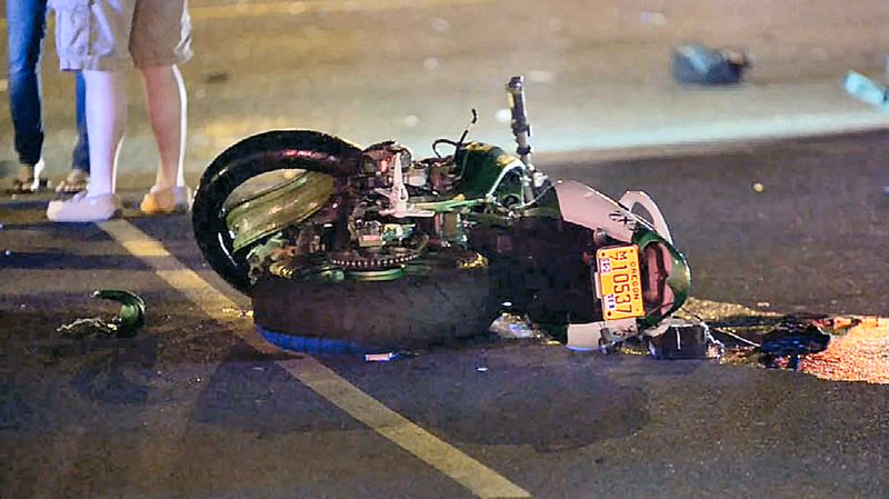by: COURTESY OF KPTV FOX 12 NEWS - The smashed motorcycle on which 34-year-old David Henry Mitchell was riding before he died in a head-on crash lies in S.E. Powell Boulevard.