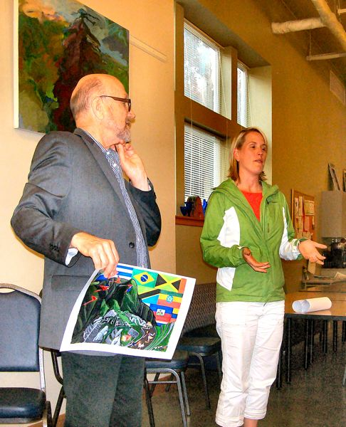 by: RITA A. LEONARD - Rick Sadle and daughter Darielle Ruff, owners of the local Salvador Mollys restaurants, showed attendees of the May BAC meeting mural designs for their new location, which opened in June on S.E. Milwaukie Avenue just north of McLoughlin.