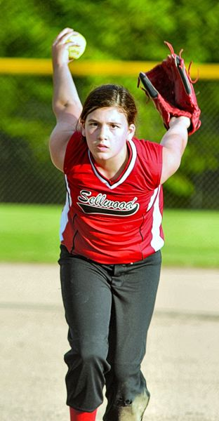 by: DAVID BALL - Olivia Jones pitches with intensity for Sellwoods Red Devils during the first game of the day, against the North Clackamas Blue Tornadoes, in the Sunday, June 15th, tournament play.