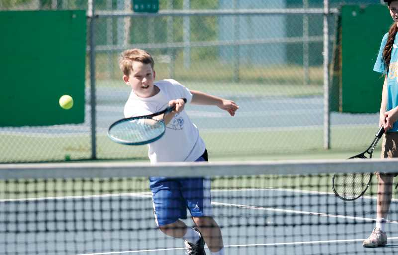 by: PHIL HAWKINS - Josiah Peterson was one of many athletes to attend Woodburn's annual tennis camp that ran from June 24-30 at Woodburn High School.