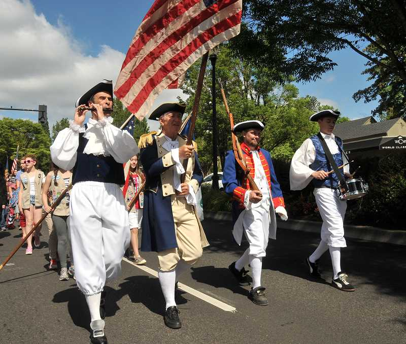 by: REVIEW FILE PHOTO: VERN UYETAKE - People in Lake Oswego love a parade, especially when its held on the Fourth of July. This year's Star Spangled Parade is expected to be bigger than ever.
