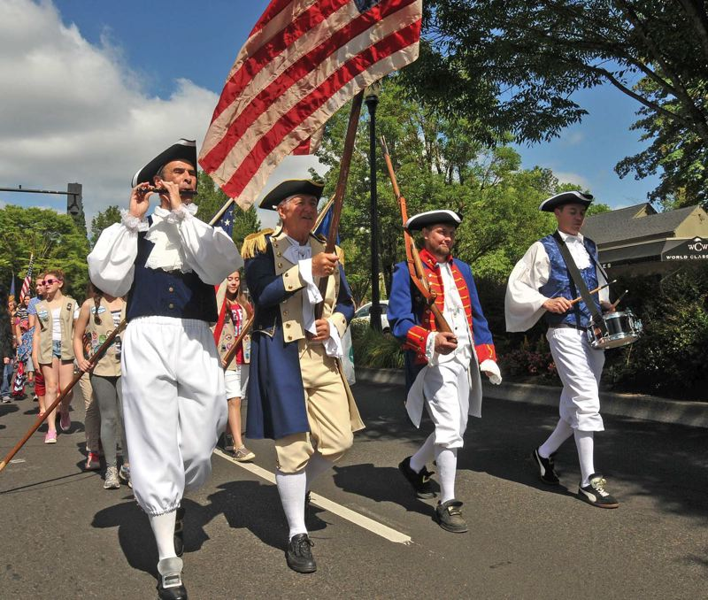 by: PAMPLIN MEDIA GROUP: VERN UYETAKE - The Fourth of July brings out the patriotic in Portland-area people, including fife and drum marchers in the Lake Oswego parade, which starts at 10 a.m.