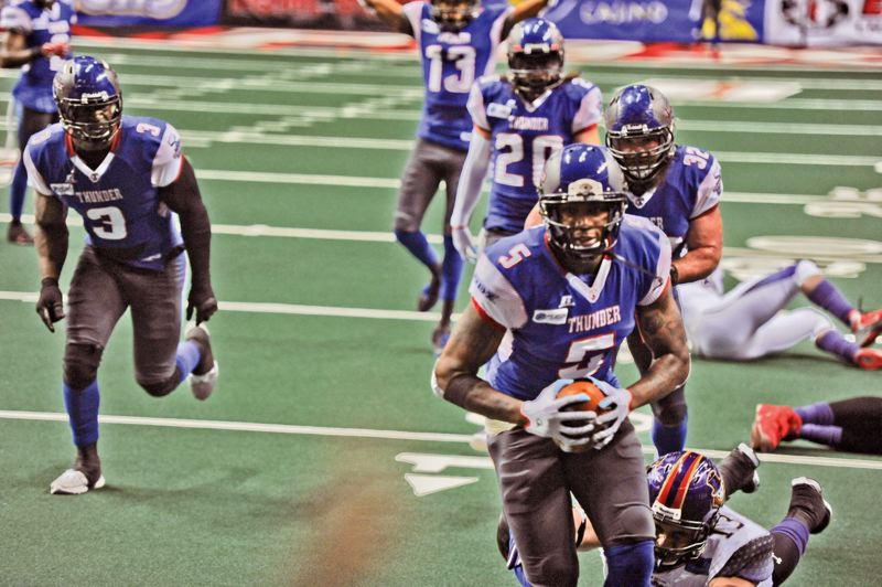 by: COURTESY OF PORTLAND THUNDER - Jamar Howard takes an onside kick by the New Orleans VooDoo to the end zone for the winning touchdown at Moda Center last week as the Portland Thunder win the Arena Football League game 62-56.