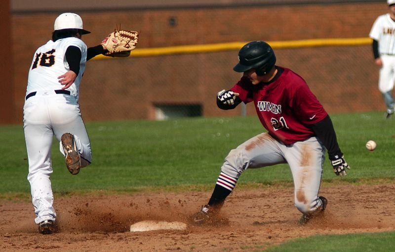 by: DAN BROOD - HE'S FAST -- Keegan Lawrence steals second base during a Bowmen win at St. Helens.