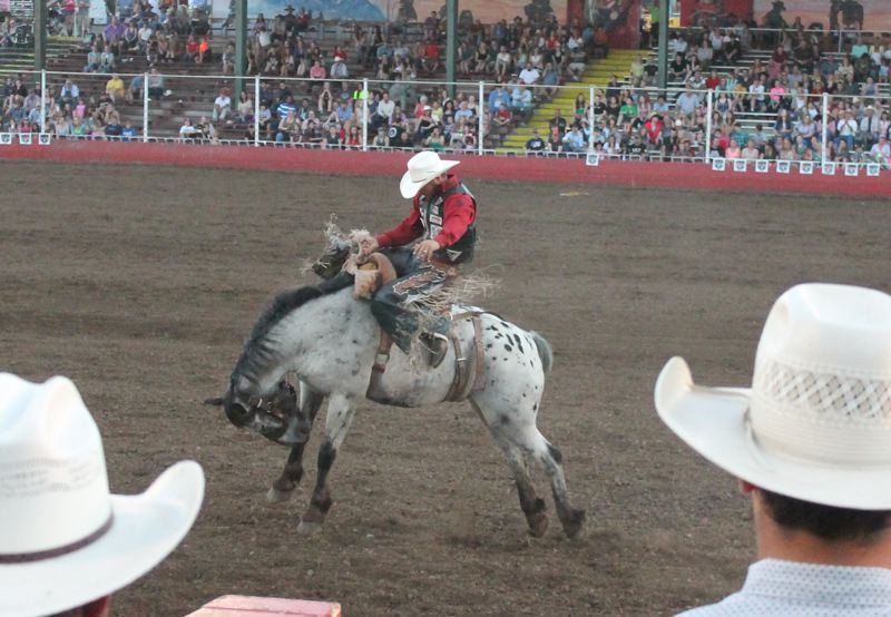 by: JIM BESEDA/MOLALLA PIONEER - Action in the 91st Molalla Buckeroo PRCA Rodeo got underway Wednesday with the first of five performances.