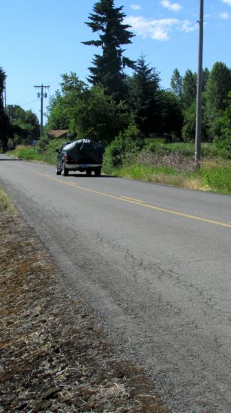 by: MARK MILLER - Fatigue cracking on East Columbia Avenue, one of many Columbia County roads scheduled for partial repaving this summer, near Scappoose.