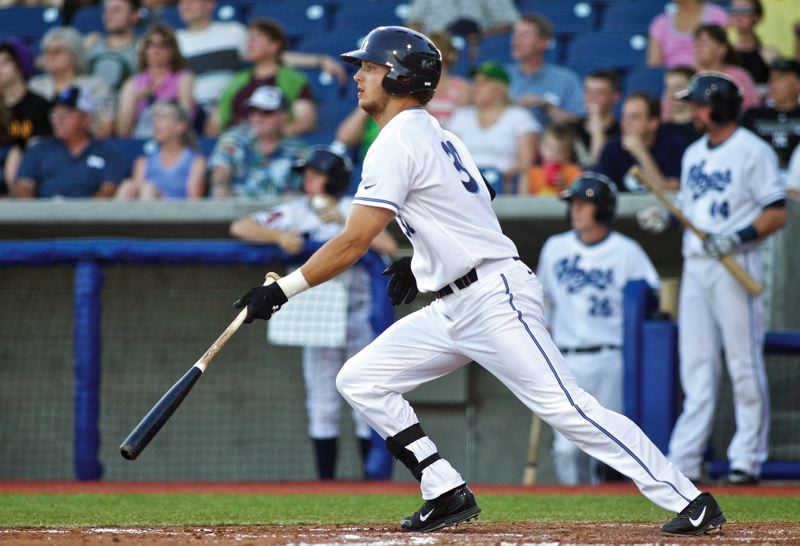 by: COURTESY PHOTO: CRAIG MITCHELLDYER - Hillsboro Hops outfielder Grant Heyman tracks the flight of a ball during Tuesday's game against the Everett AquaSox. Heyman is off to a hot start this season with a .318 batting average.