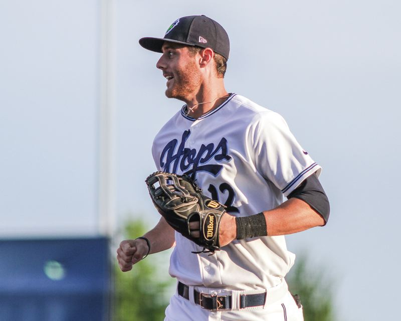 by: HILLSBORO TRIBUNE PHOTO: CHASE ALLGOOD - Hillsboro Hops outfielder Todd Glaesmann is all smiles during a recent game at Ron Tonkin Field. Glaesmann, a former third-round draft pick, was promoted to Class AA after batting .404 in 14 games for the Hops.