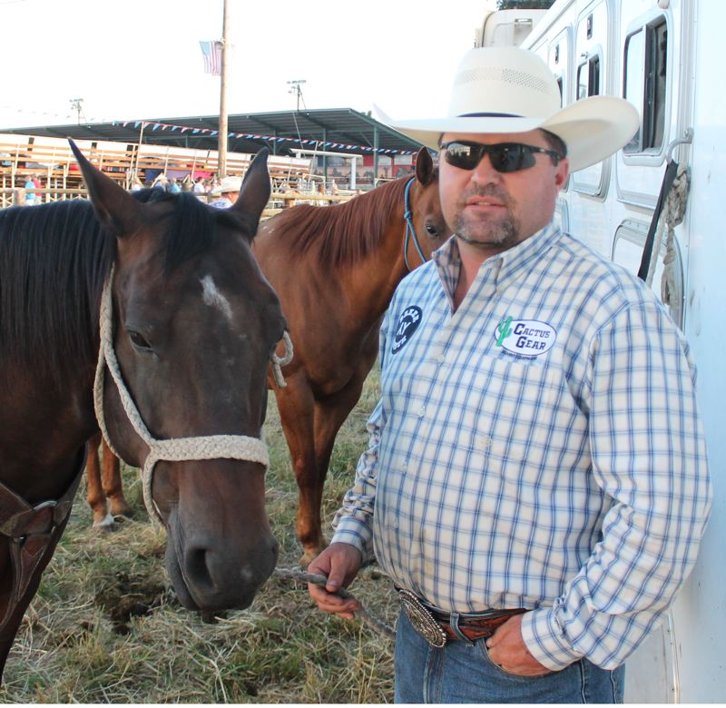by: JIM BESEDA/MOLALLA PIONEER - Team roper Bucky Campbell of Benton City, Wash., and his 9-year-old bay Bulldog had a good night at Thursday's 91st Molalla Buckeroo PRCA Rodeo.