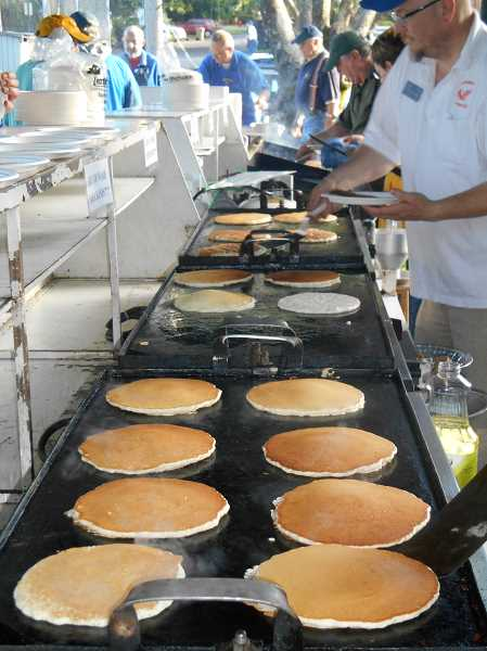by: REVIEW PHOTO: GARY M. STEIN - The Lake Oswego Lions Club expects to feed 3,000 pancake lovers on July 4.