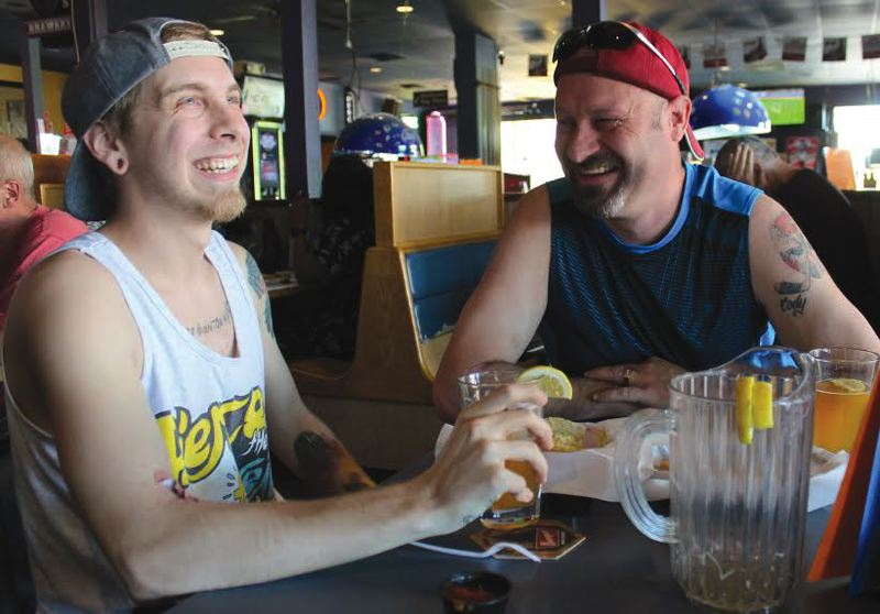 by: OUTLOOK PHOTO: LISA K. ANDERSON - Father-son duo Cody and Gil Fitzpatrick have bonded over World Cup soccer games the past couple weeks. Both call the sport unifying.