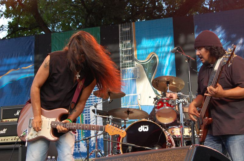 by: TRIBUNE PHOTO: KEVIN ANSPACH - Los Lonely Boys' Henry Garza, left, and JoJo Garza performed Thursday evening at the Safeway Waterfront Blues Festival. Their brother, Ringo Garza Jr., is playing the drums. The four-day event is a fundraiser for the Oregon Food Bank.