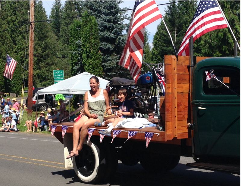 by: OUTLOOK PHOTO: LAURA KNUDSON - Those riding in the parade, enjoyed the sunny skies and warm temperatures, visiting with the crowd on their way by.