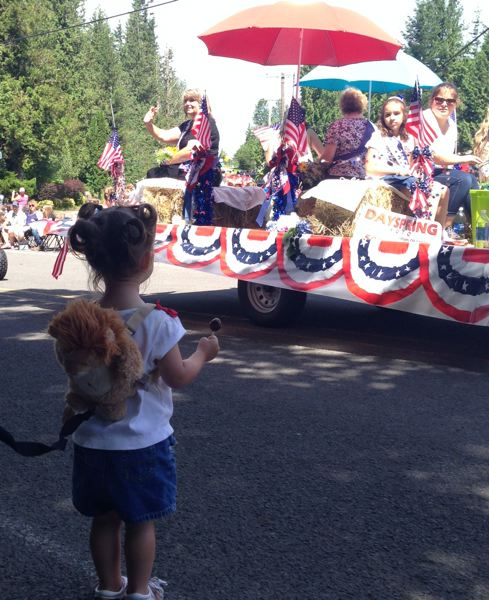 by: OUTLOOK PHOTO: LAURA KNUDSON - Suzanne Johnson had attended the fun fest before, but this year, she brought her two-year-old granddaughter, who waved as the parade passed by and quickly caught on to picking up candy.