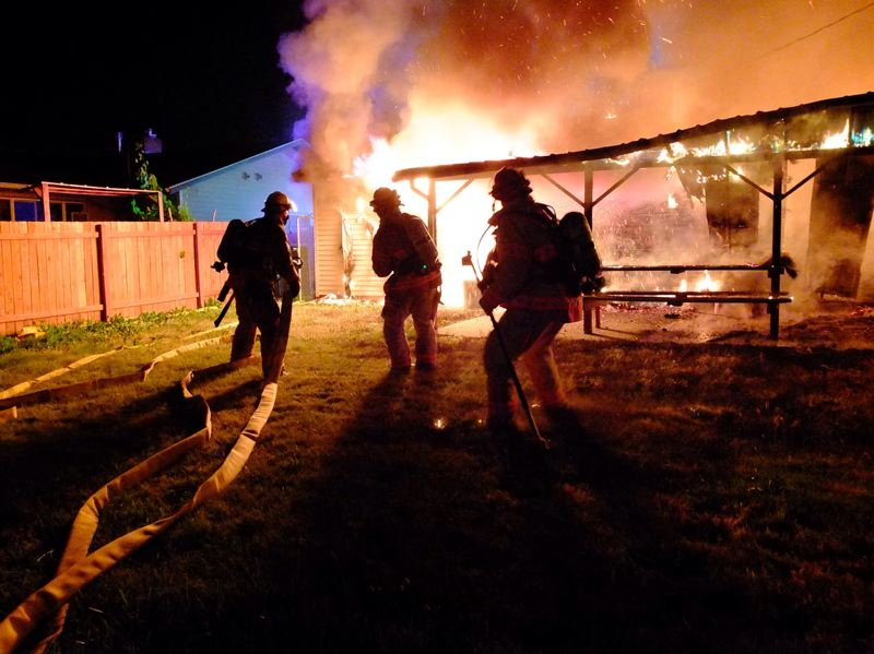 by: COURTESY OF PORTLAND FIRE AND RESCUE - Illegal fireworks were blamed for the fire that destroyed this Southeast Portland home Saturday night, July 5.
