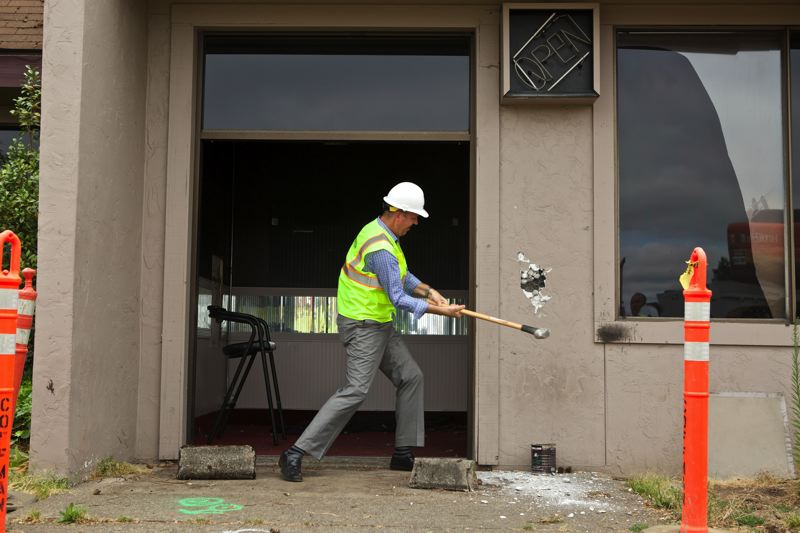 by: TIMES PHOTO: JAIME VALDEZ - CenterCal Properties general manager Chad Hastings swung a sledge hammer into the Jiggles building, which was torn down to make room for three sit-down restaurants.