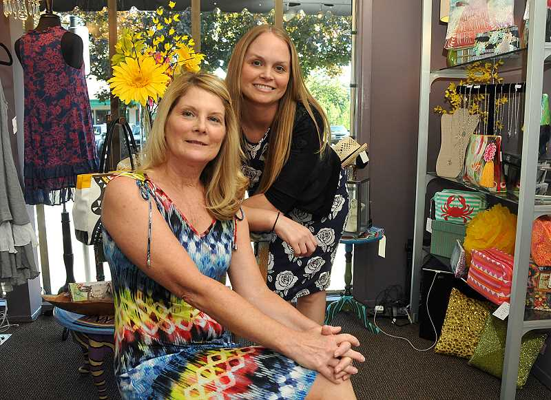 by: STAFF PHOTOS: VERN UYETAKE - Karen Cartwright, left, and her daughter, Lizzie Cartwright, have opened Flying Monkey, a retail store selling womens clothing and accessories in Lake Oswego.