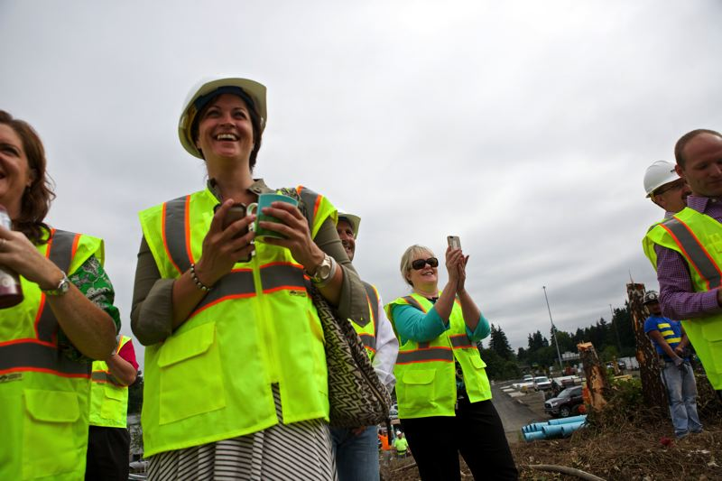 by: TIMES PHOTO: JAIME VALDEZ - A crowd of city officials and others gathered to watch as Jiggles was torn down on Monday, July 7.