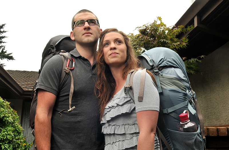 by: TIDINGS PHOTO: VERN UYETAKE  - Derek and Sarah Gill will live out of these backpacks for the next 11 months during their misionary trip to 11 countries.