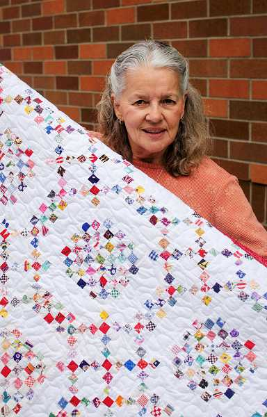 by: RAY HUGHEY - Former Canby resident Sandy Monaco would like to find the family of the Word War II serviceman whose quilt she finished.