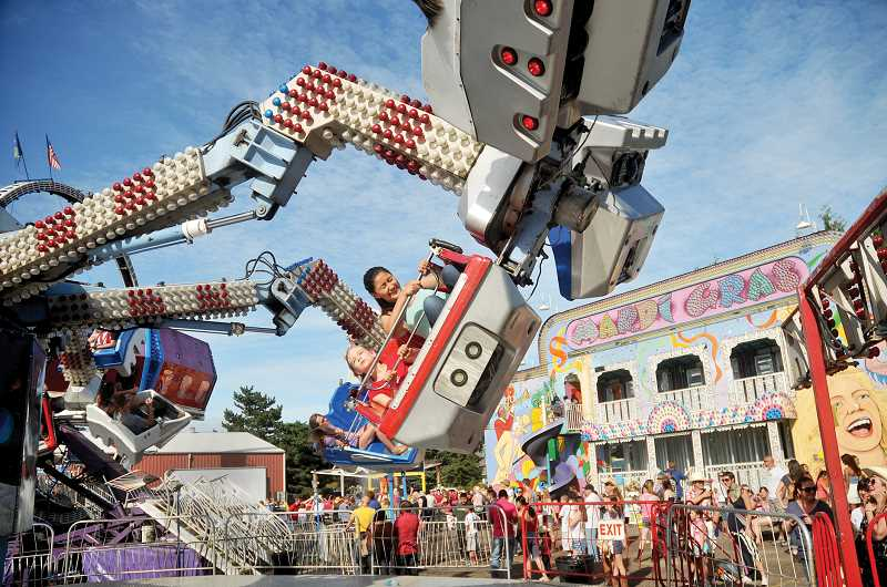 by: GARY ALLEN - There was also a wide variety of activities for all ages, including carnival rides.