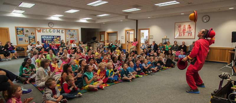 by: SPOKESMAN PHOTO: JOSH KULLA - Comedic Juggler Rhys Thomas entertains a room full of children June 26 at the Wilsonville Library.