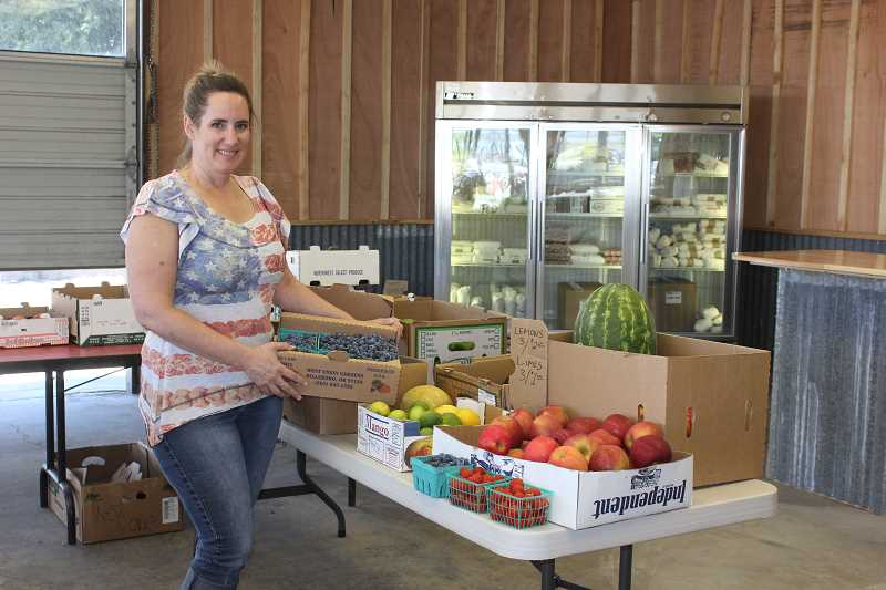 Jennifer DuPont shows some of the produce at Wild Winds Station.