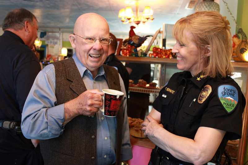 by: NEWS-TIMES: KATE STRINGER - Charles McAvoy recites one of his limericks to Forest Grove Police Chief Janie Schutz at the police departments second Coffee with a Cop event at Maggies Buns last Wednesday.