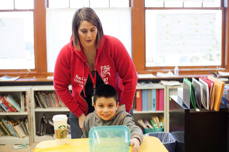 by: COURTESY PHOTO: PARRISH EVANS - Tristan Jarmer, who is pursuing her master of arts in teaching degree at Pacific University in Forest Grove, teaches a class filled with economically disadvantaged students at Reedville Elementary in Hillsboro.