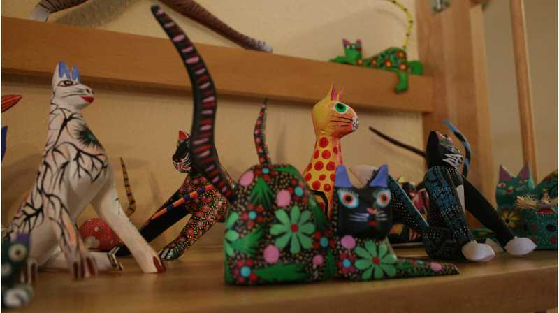 by: RACHEL LYNN ALDRICH - Lebold's largest collection of foreign cats is the colorful collection of hand-carved cats from Oaxaca, Mexico.