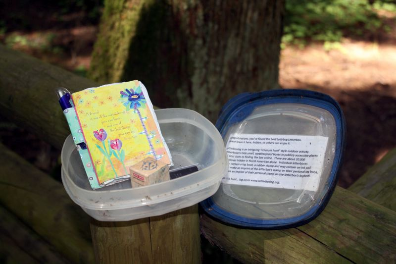 by: POST PHOTO: KYLIE WRAY - Each box contains a stamp (sometimes with its own ink pad) and a logbook for treasure hunters to sign their trail names.