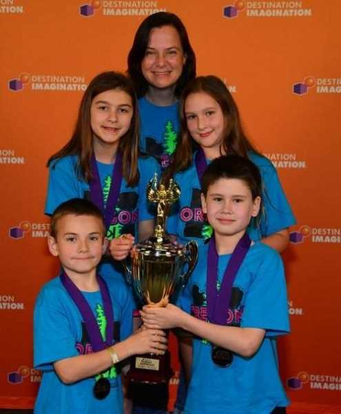 by: SUBMITTED PHOTO - From left: William Mueller, Gabby Calvi, Team Manager Deborah Mueller, April Straus and Owen Pickering are homeschoolers on the Theories of DI-Tivity team competing in Destination Imagination challenges.