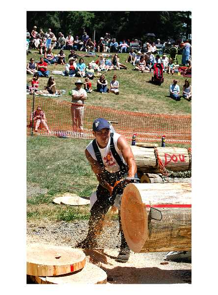 by: ISABEL GAUTSCHI - The 2014 Timber Festival drew thousands to Timber Park to watch the logging competitions. Above: Ben Clark is a contender in the stock saw event.