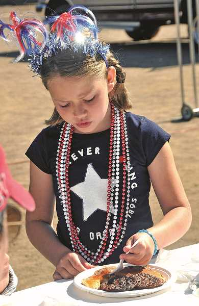 by: REVIEW PHOTO: VERN UYETAKE - Callie Walton dressed in her patriotic finest for Friday morning's Lions Club pancake breakfast.