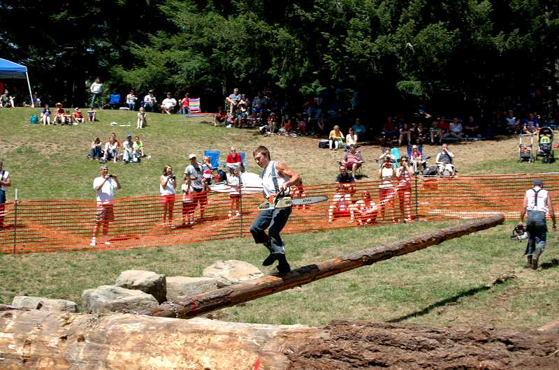 by: ISABEL GAUTSCHI - Daniel Wood competes in the obstacle pole event in the Timber Festival.