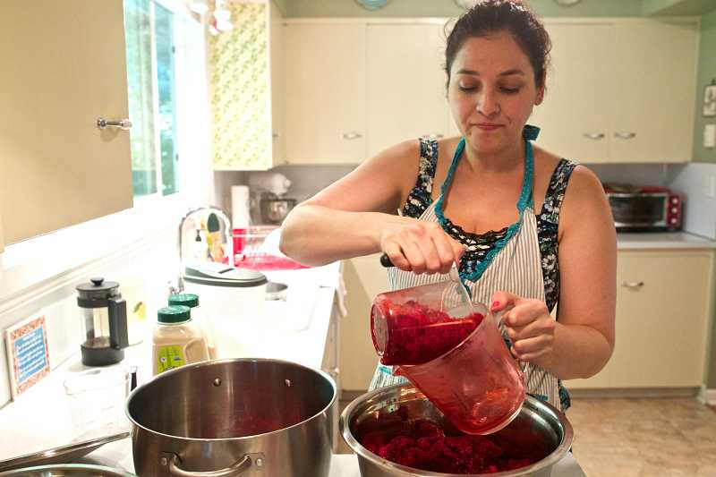 by: TIMES PHOTO: JAIME VALDEZ - Becky Morse measures out raspberries before making jam at her home in Tualatin. Morse sells her jam most Fridays from 4 to 8 p.m. at the Tualatin Farmers Market.