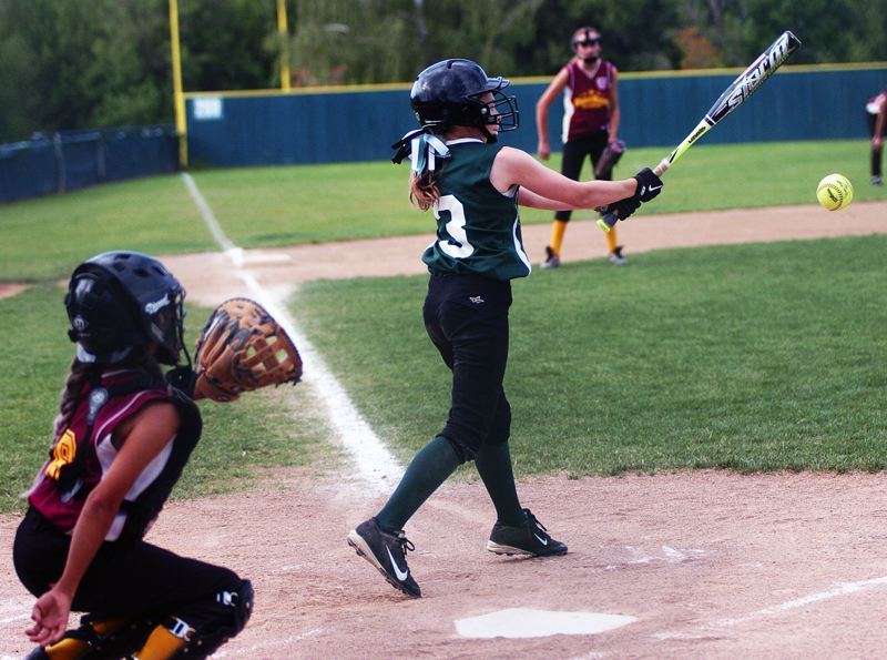 by: DAN BROOD - INTO PLAY -- Tigard's Emily Torres hits an infield single during the second inning of the team's District 4 Tournament title-game victory.