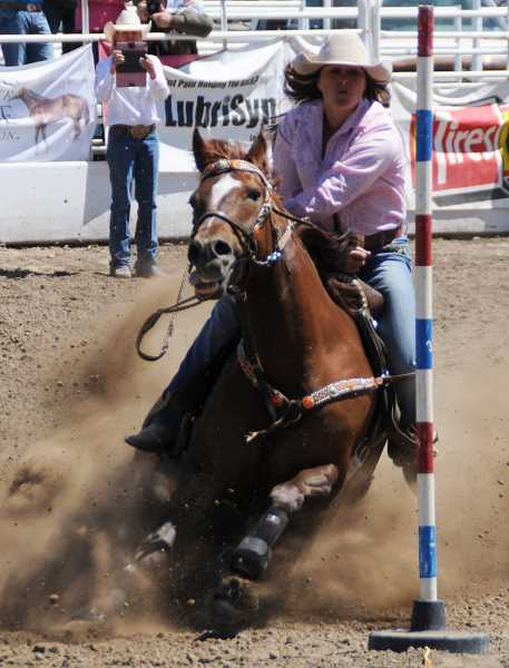 by: LON AUSTIN/CENTRAL OREGONIAN - Riley Sappington makes a pole bending run during the Oregon High School State Finals Rodeo. Sappington recently placed in both the first go round and the average at the Silver State International Rodeo in Winnemucca, Nev. Sappington was one of four athletes from Crook County to place in the rodeo.