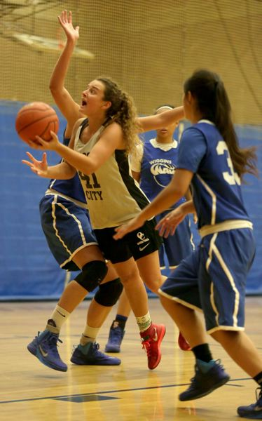 by: JON HOUSE - Taylor Shaw, pictured on the attack in the sixth-place final of the 2014 End Of The Trail High School All-Star Basketball Tournament, was selected to the tournaments National Division All-Star Team.