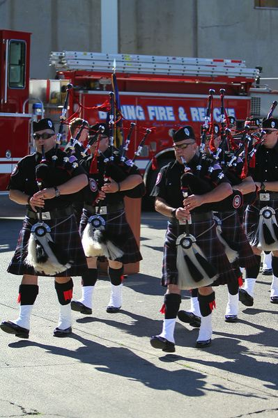 by: PHOTO COURTESY: BRANDON PAXTON - Clackamas Firefighters Pipes and Drums plays for the crowd of firefighters, their families and the gathered curious members of the public after the ceremony.