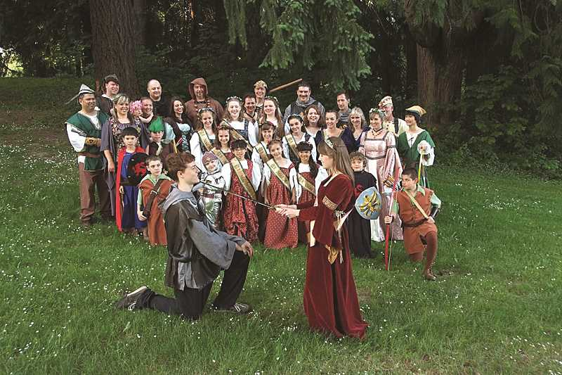 by: COURTESY PHOTO: CINDY CADDELL - Maid Marian knights one of her loyal subjects as members of the Maid Marian Royal Court, including Robin Hood and his Merryman (and Merrywomen), look on.