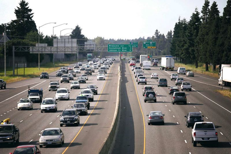 by: TRIBUNE PHOTO: JONATHAN HOUSE - Evening rush hour starts to jam both directions on I-205 in Clackamas County. ODOT officials say traffic is getting worse in some areas. To combat that, the agency has launched a series of new signs offering information on congestion and drive times.