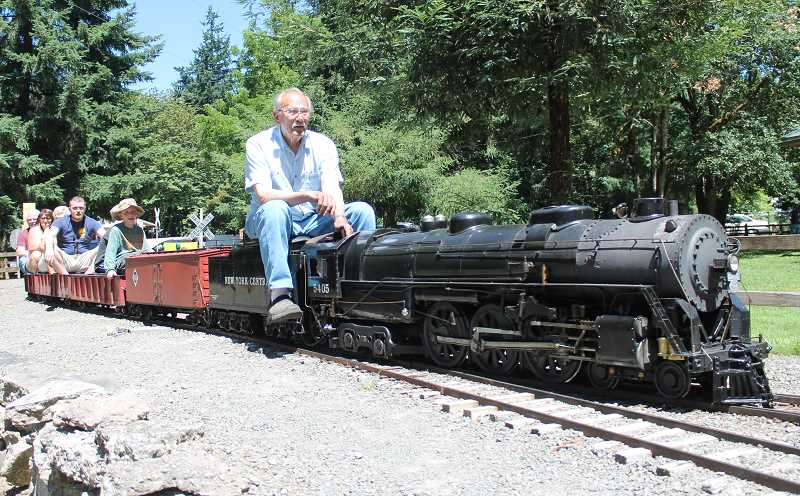 by: JIM BESEDA/MOLALLA PIONEER - Larry Anderson, 82, takes visitors to the Molalla Train Park for a ride.