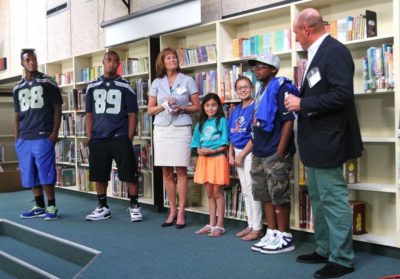 by: OUTLOOK PHOTO: JIM CLARK - Yasmin and Maria Galdamez and Kemarey Fuller, center, speak about what the Seahawks' visit meant to them during the Thursday, July 10 event.