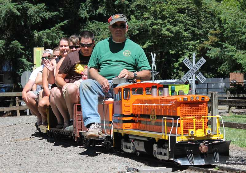 by: JIM BESEDA/MOLALLA PIONEER - Dave Middleton of Hillsboro was at the controls of one of 12 trains running at the Molalla Train Park during a recent Sunday afternoon.