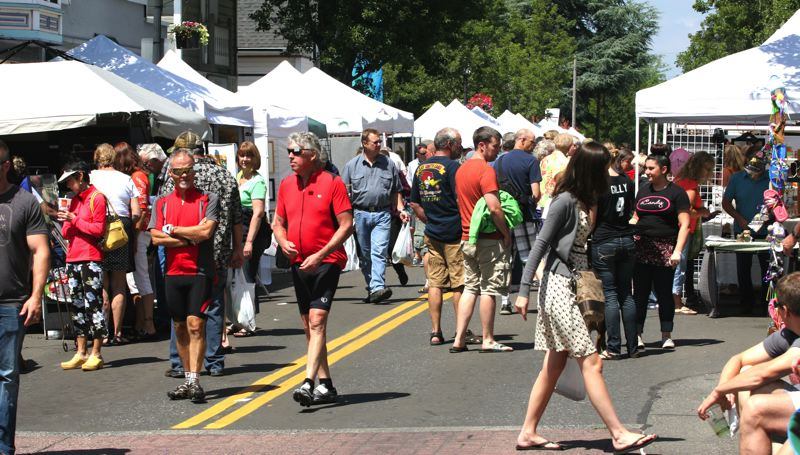 by: FILE PHOTO - The Gresham Arts Festival draws crowds each year to downtown, where artisans display their works and musicians perform on various streets.