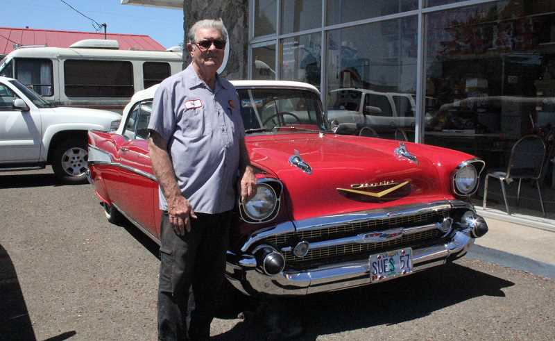 by: LINDSAY KEEFER - Tom McCain, this year's grand marshal, stands by his 1957 Chevy, which he will likely ride in during the parade July 19.